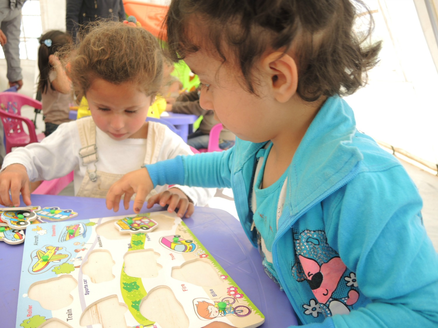 Children inside tented preschool in Bekaa Valley Lebanon
