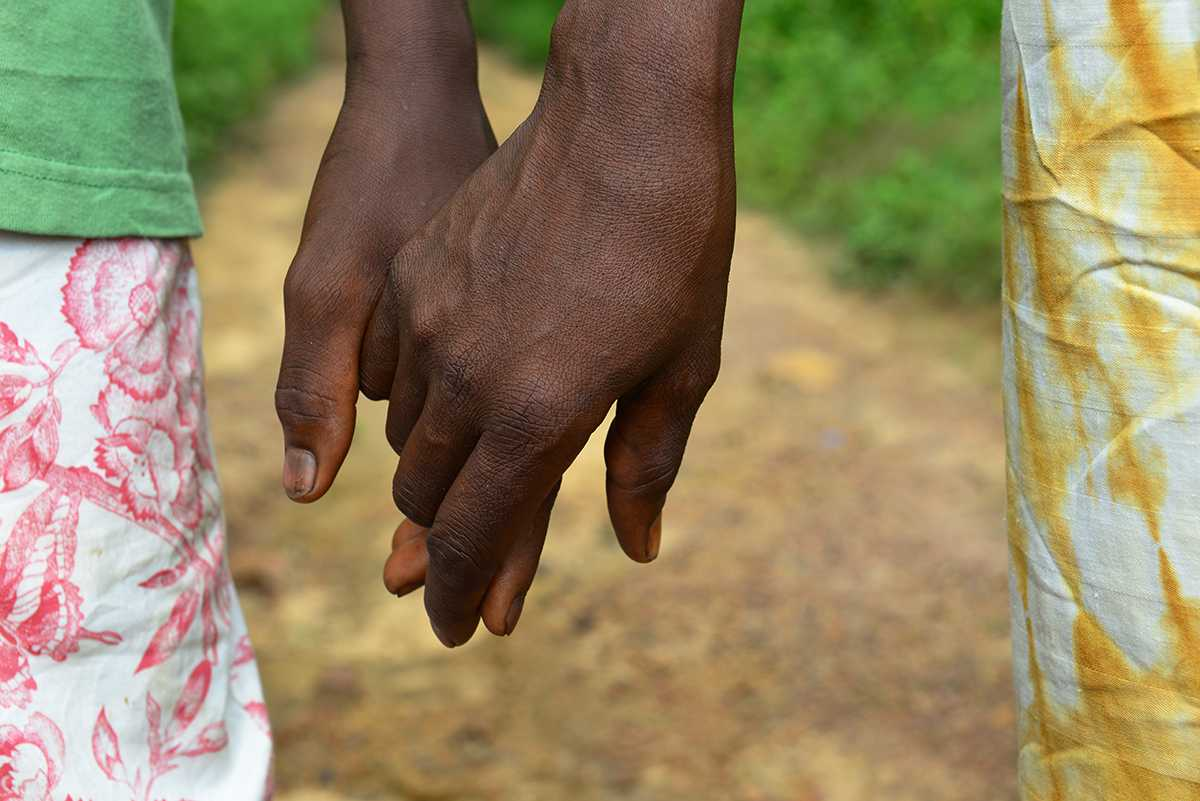 Mother and son holding hands during Ebola crisis