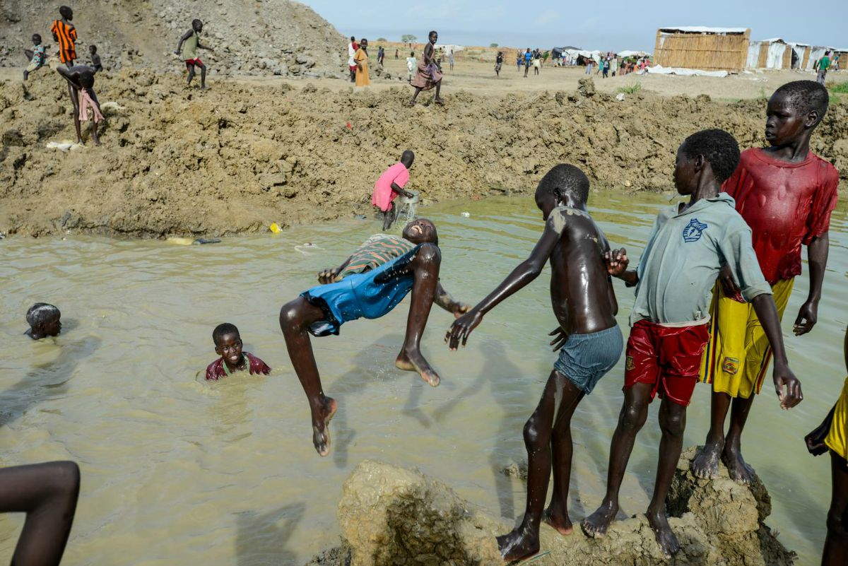Children around a watering hole in Bentiu South Sudan