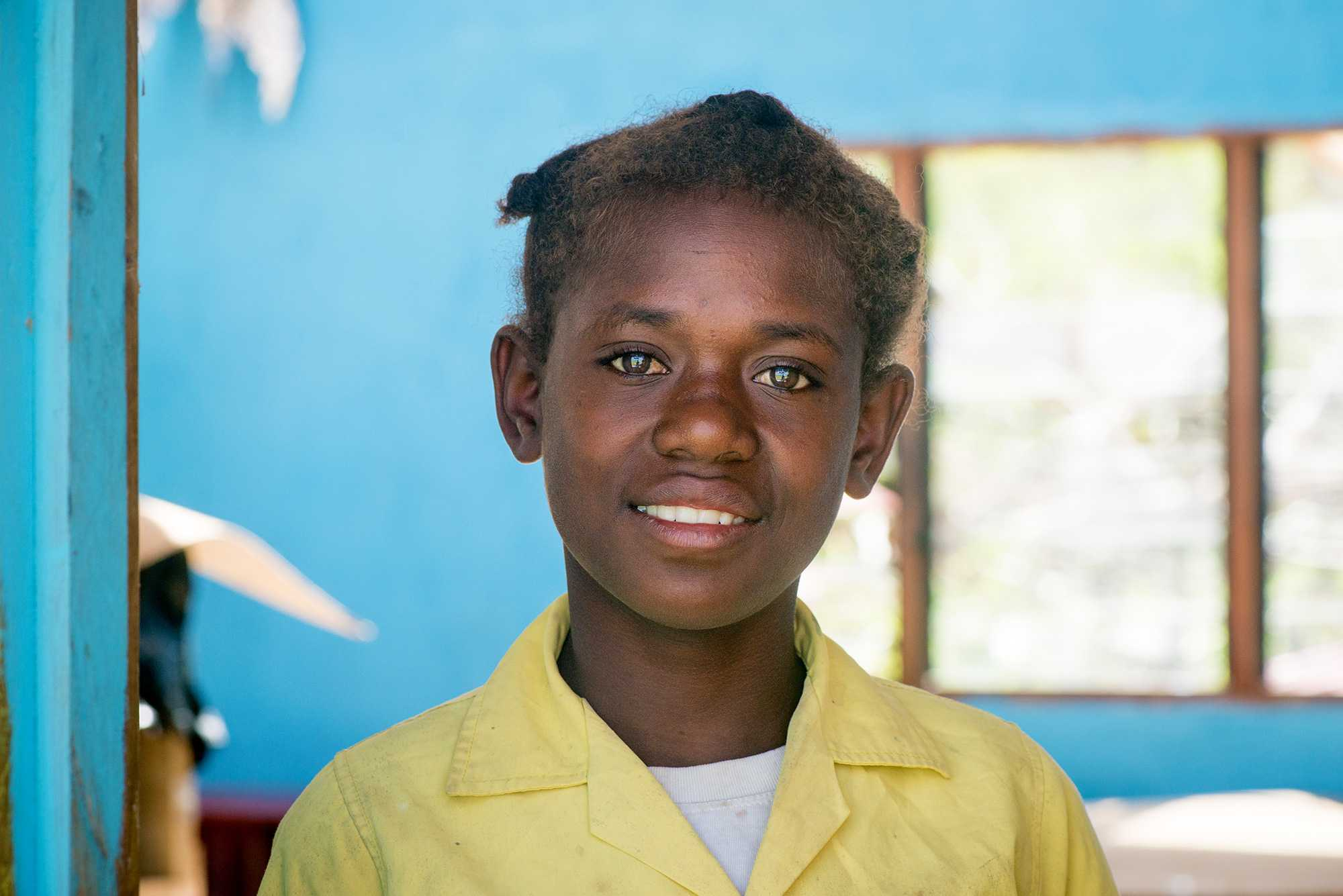Student in the remains of St Josephs Primary School after Cyclone Pam