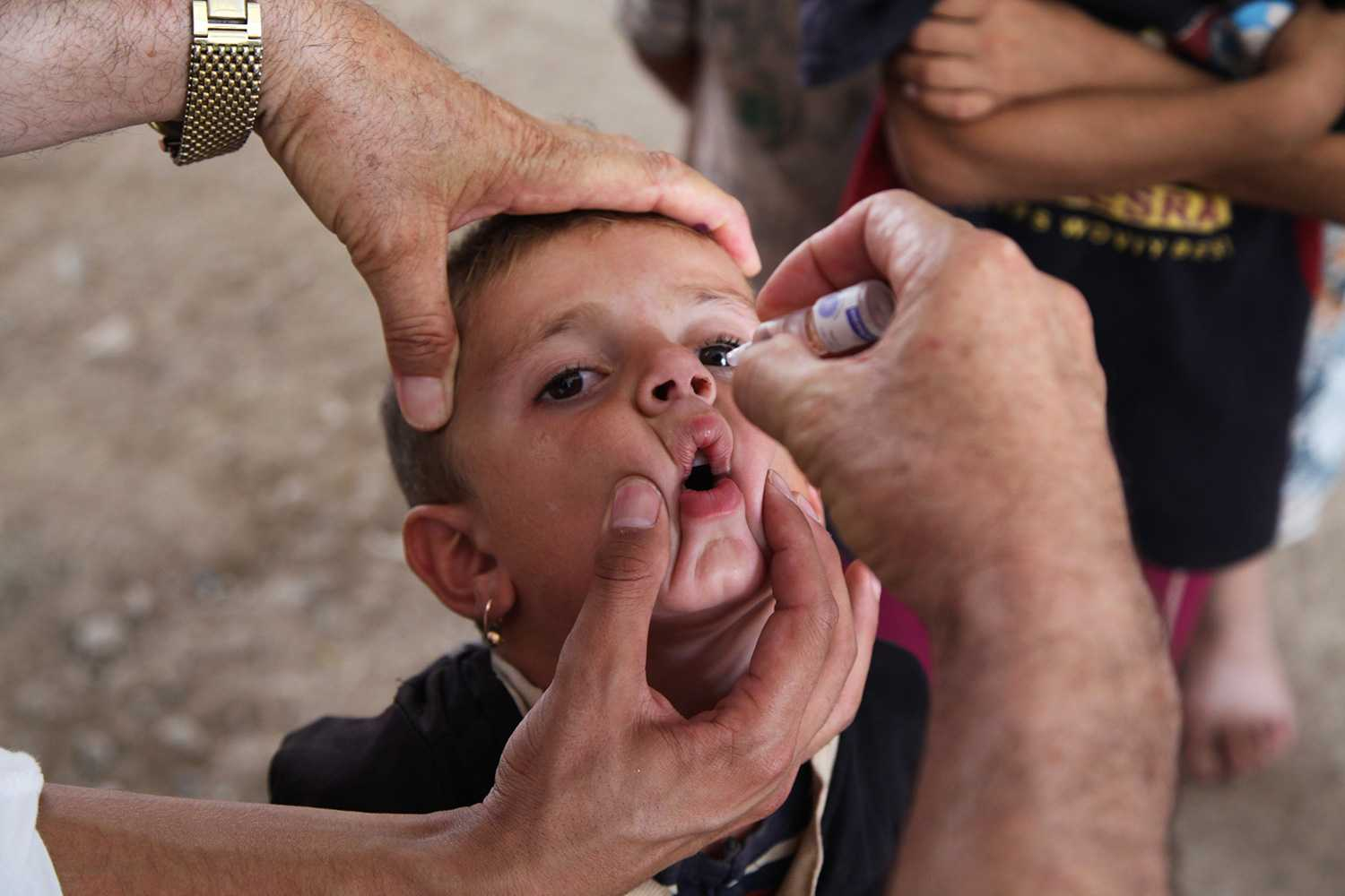 Young boy receiving polio vaccination