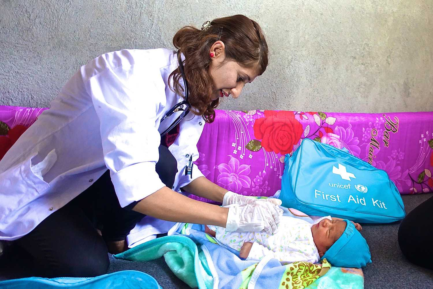 Volunteer nurse giving baby a neo-natal check up