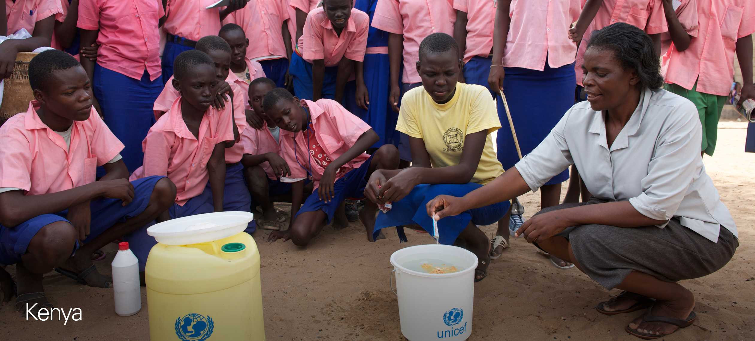 Teacher purifying the water for her students at a school in Lodwar